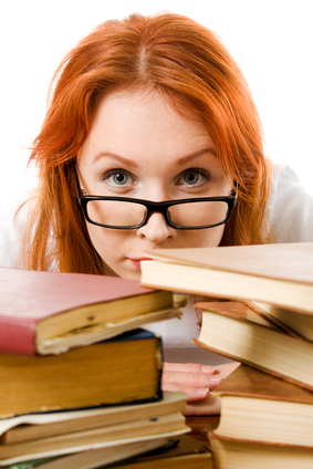 Woman using Too Many PMP Exam Prep Books